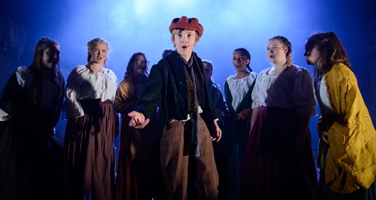 Felsted pupils perform a number from Les Miserables, in full costume