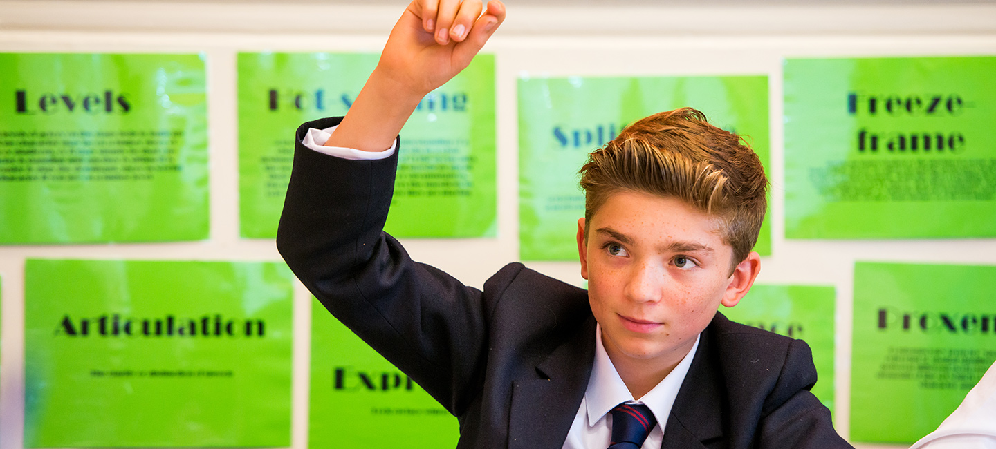 A student raising his hand