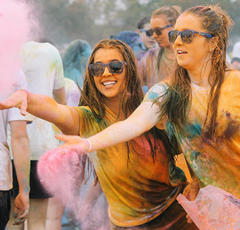 Girls covered in colorful powder