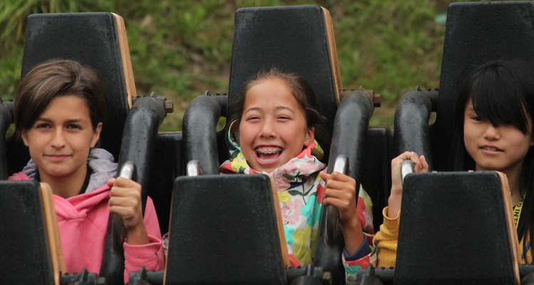 Felsted Summer School pupils enjoying themselves on a roller coaster