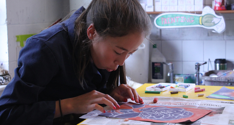 A Felsted girl producing work in an art class