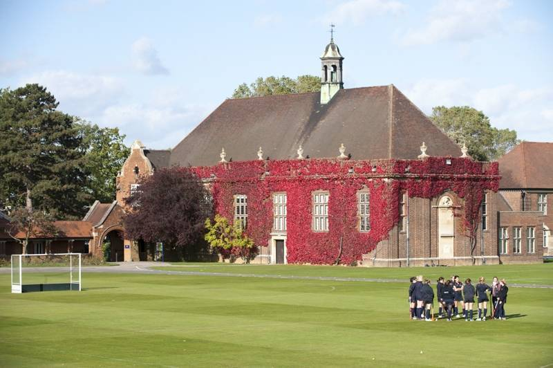 Felsted girls hockey team talking in the school grounds