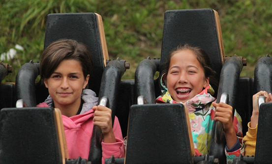Two students in an amusement ride