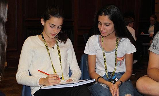 Two students sharing notes